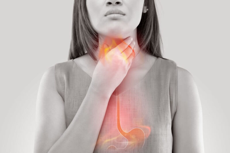 woman with acid reflux symptoms
